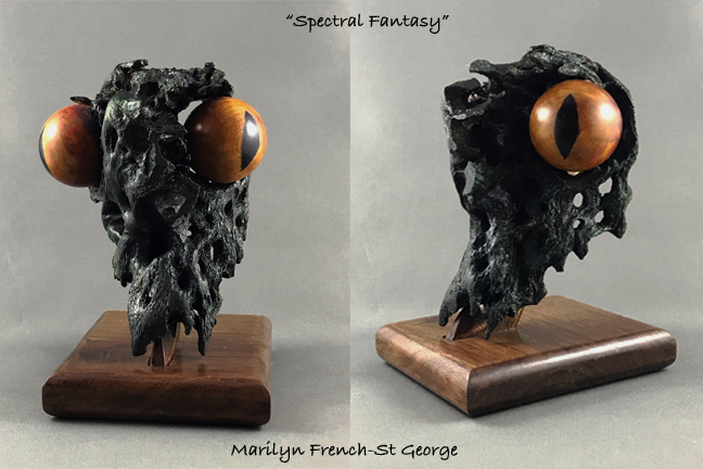 """A 3D small sculpture (5.5""""x4""""x4"""") using a cholla branch skeleton that looks like a reptilian skull. Colored and turned eyeballs are inserted into natural hollows"""